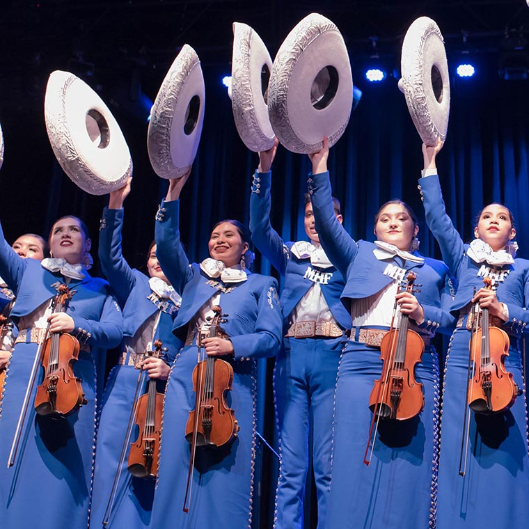 mariachi band members in square photo