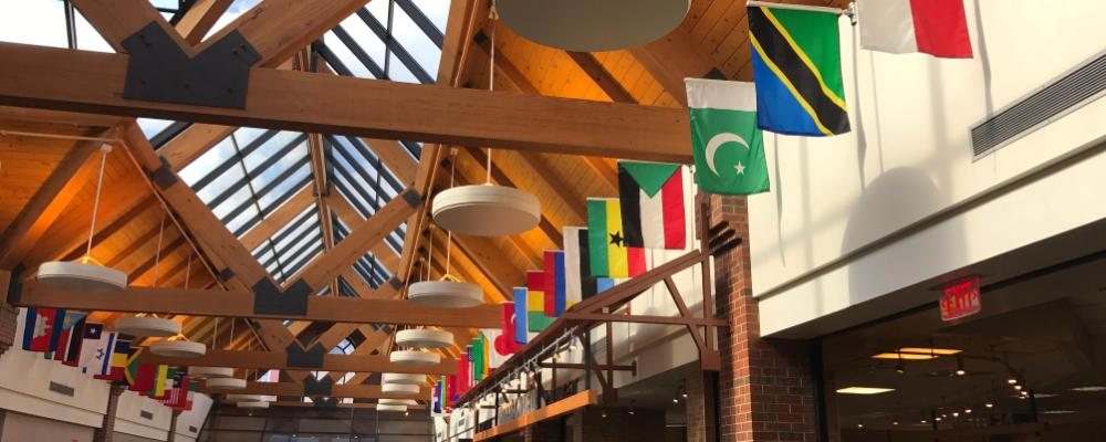 flags hanging in the dining hall at Wheaton College
