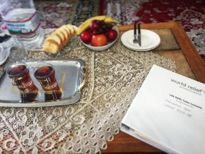 World Relief Tutor Binder on a table with cups of tea, fruit, and water