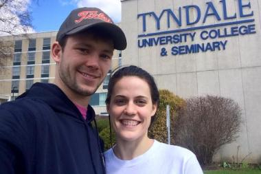 Spencer and spouse standing in front of Tyndale College