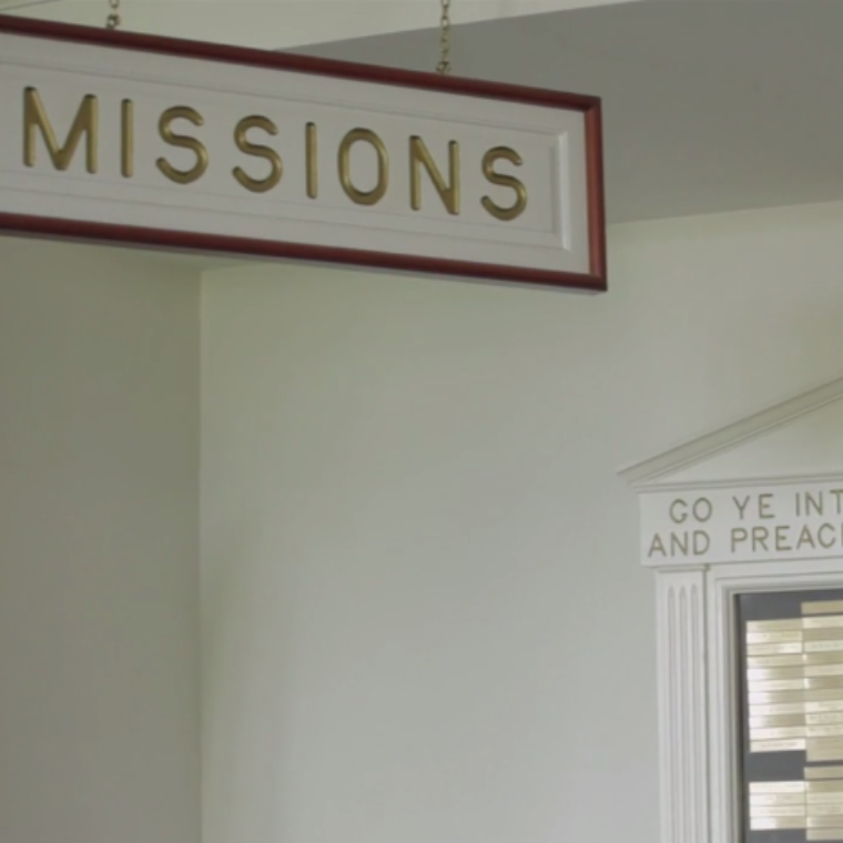 A sign with the word Missions written on it