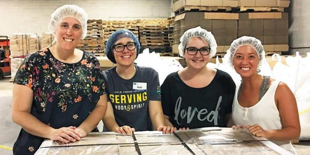 Students volunteering at Feed My Starving Children