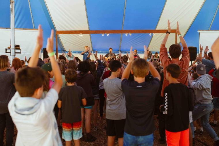 campers worshipping at honeyrock