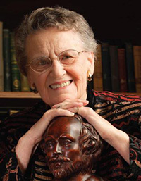 photo of past professor beatrice batson with Shakespeare bust