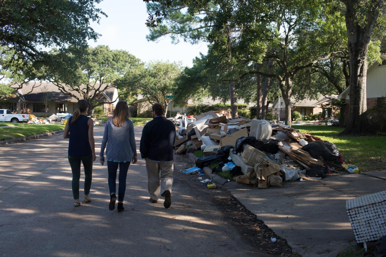 Students in aftermath of Hurricane damage with HDI in Houston