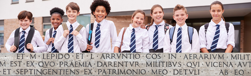 Classical School Students with Latin Banner