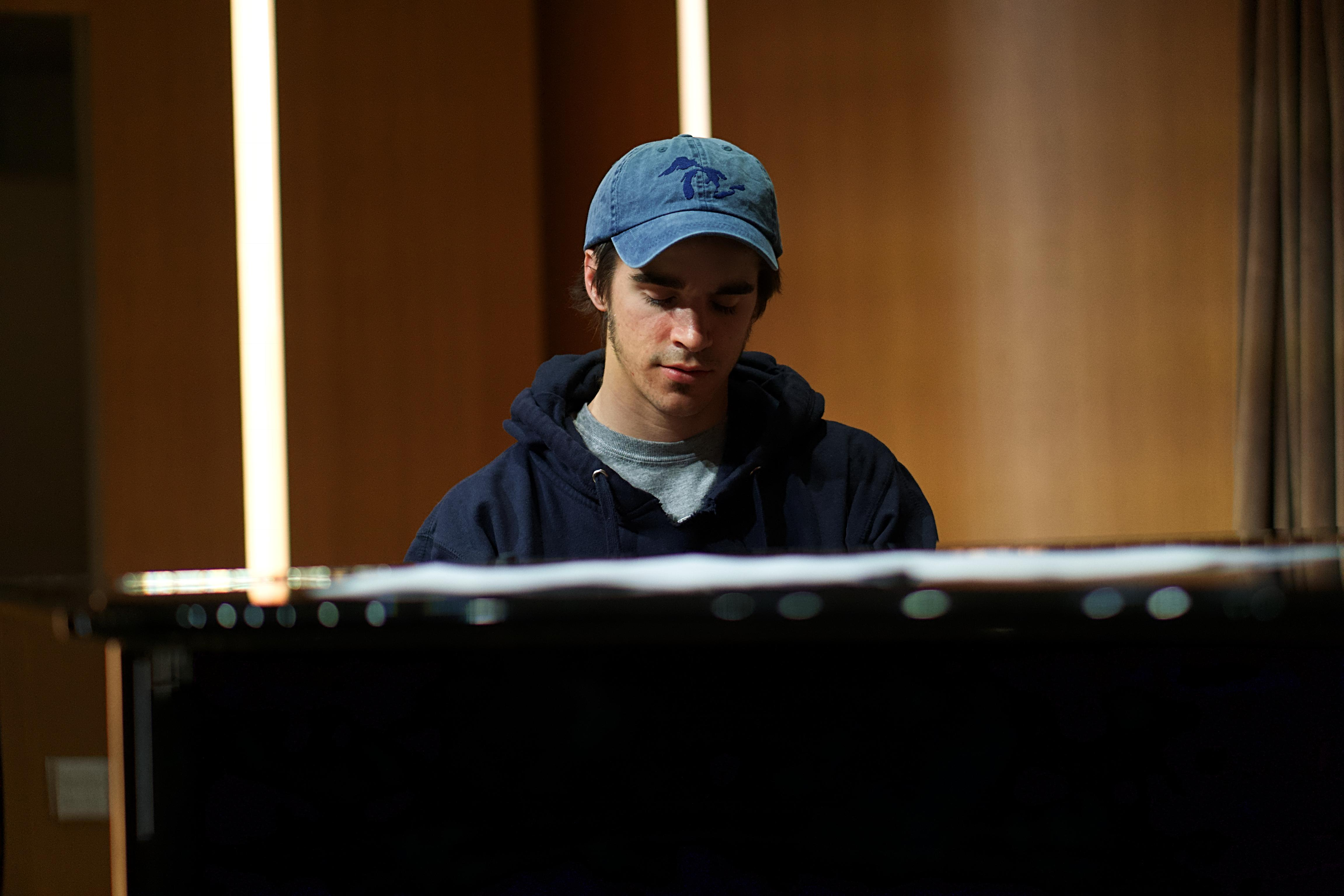 Close up photo of Jesse Dunn playing the piano