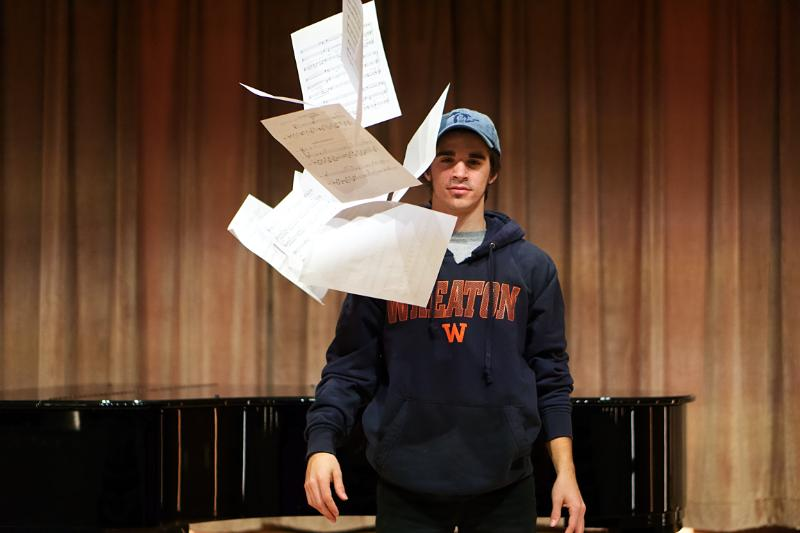 Jesse Dunn throwing his music sheets in the air