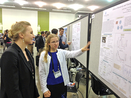 Wheaton College Physics Student April Futch presenting her research at the APS-DPP meeting in San Jose, CA.