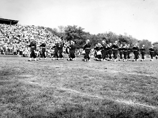 Wheaton College IL ROTC band performs at halftime during 1956 homecoming football game